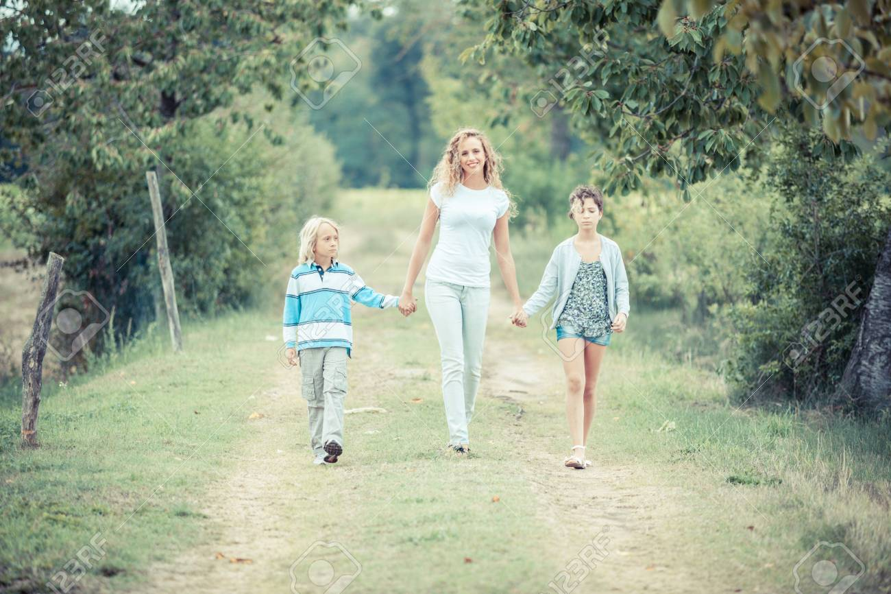 Beautiful Young Woman with Two Children Outside Stock Photo - 15121889