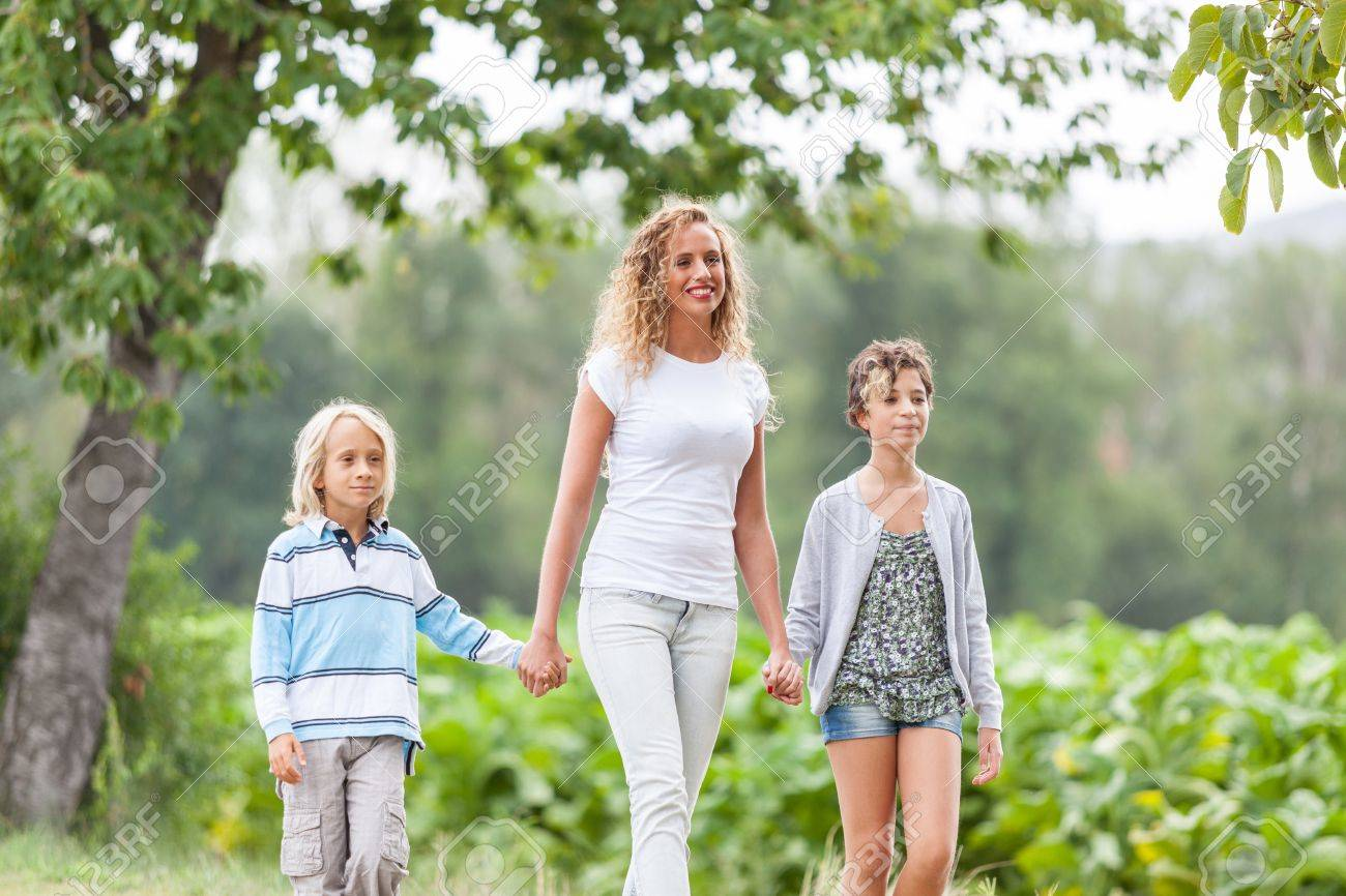 Beautiful Young Woman with Two Children Outside Stock Photo - 15531763