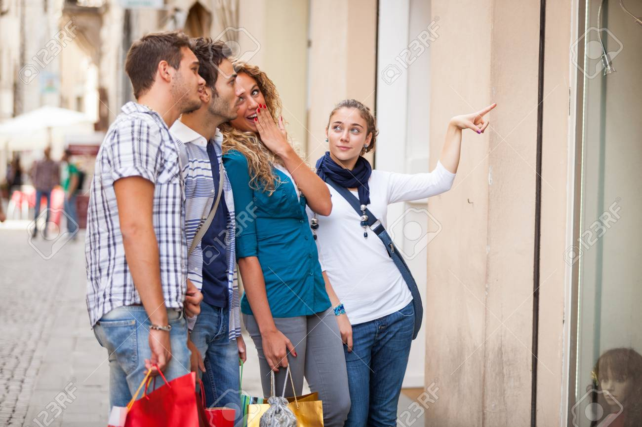 Happy Girls With Bored Boys on Shopping Stock Photo - 17220589