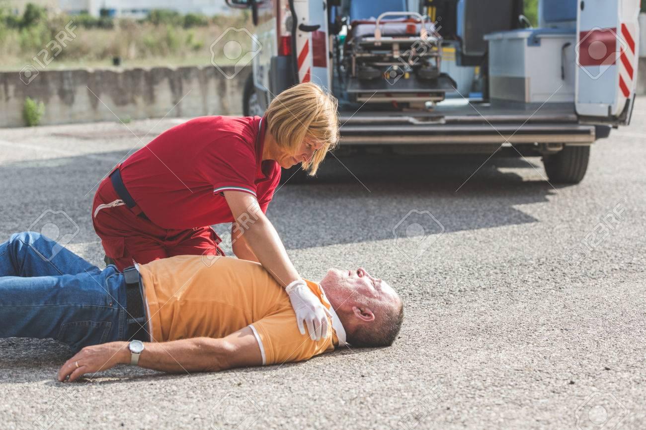 Rescue Team Providing First Aid - 35364508