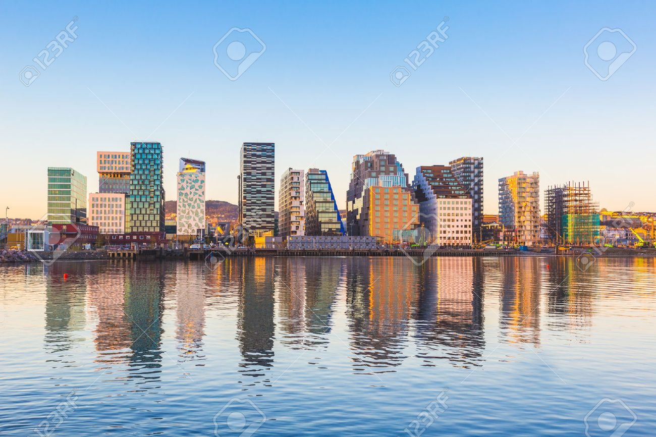 Modern buildings in Oslo, Norway, with their reflection into the water. These are some of the new buildings in the neighbourhood of Bjorvika. Concepts of travel and architecture. - 50883307