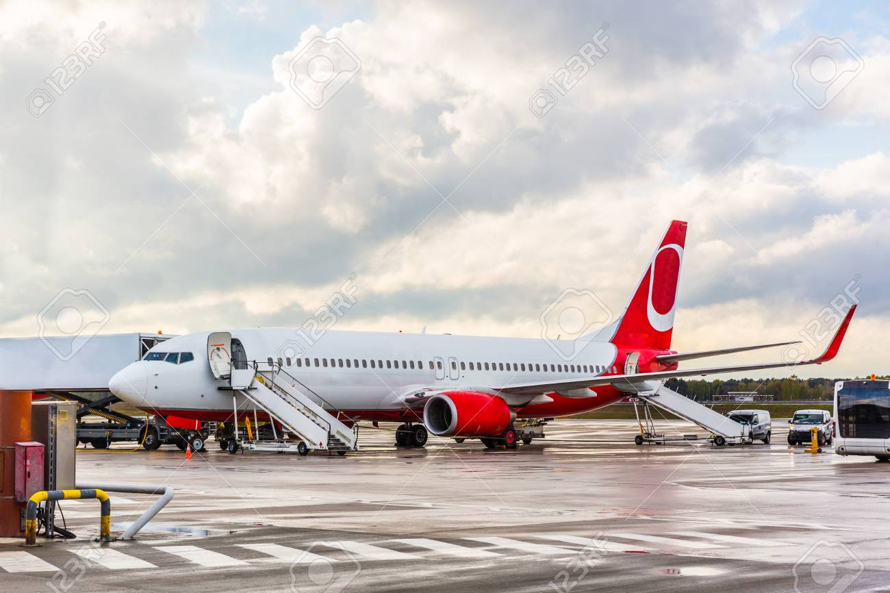 Airplane waiting for passengers at airport. Jet plane with open doors and boarding ladders ready & Airplane Waiting For Passengers At Airport. Jet Plane With Open ...