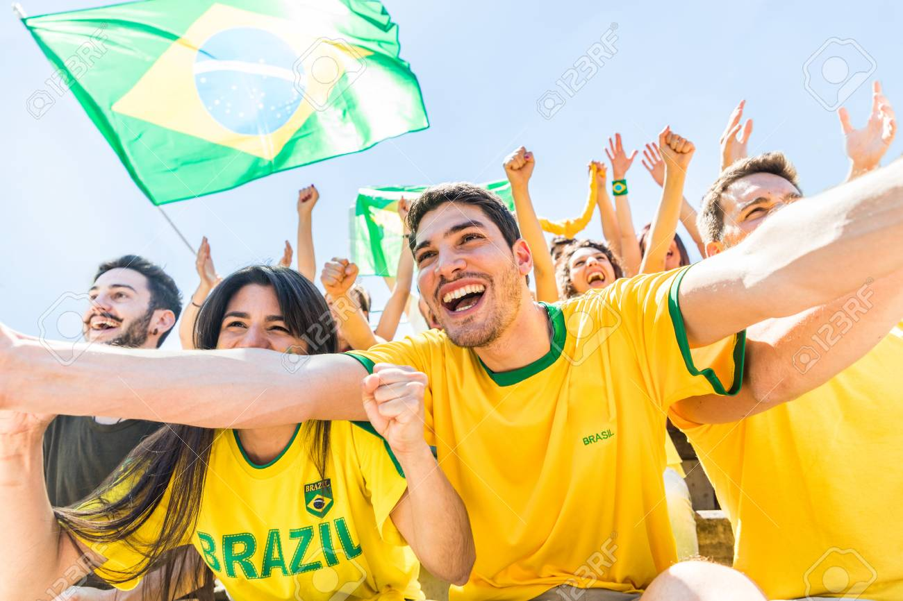 Brazilian supporters celebrating at stadium with flags  Group