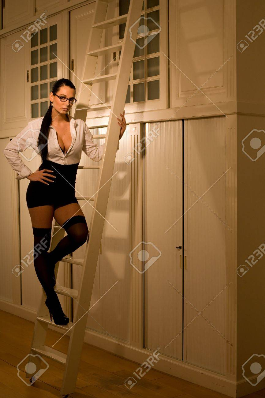 Very beautiful and sexy secretary is working late at the office Stock Photo - 11927834