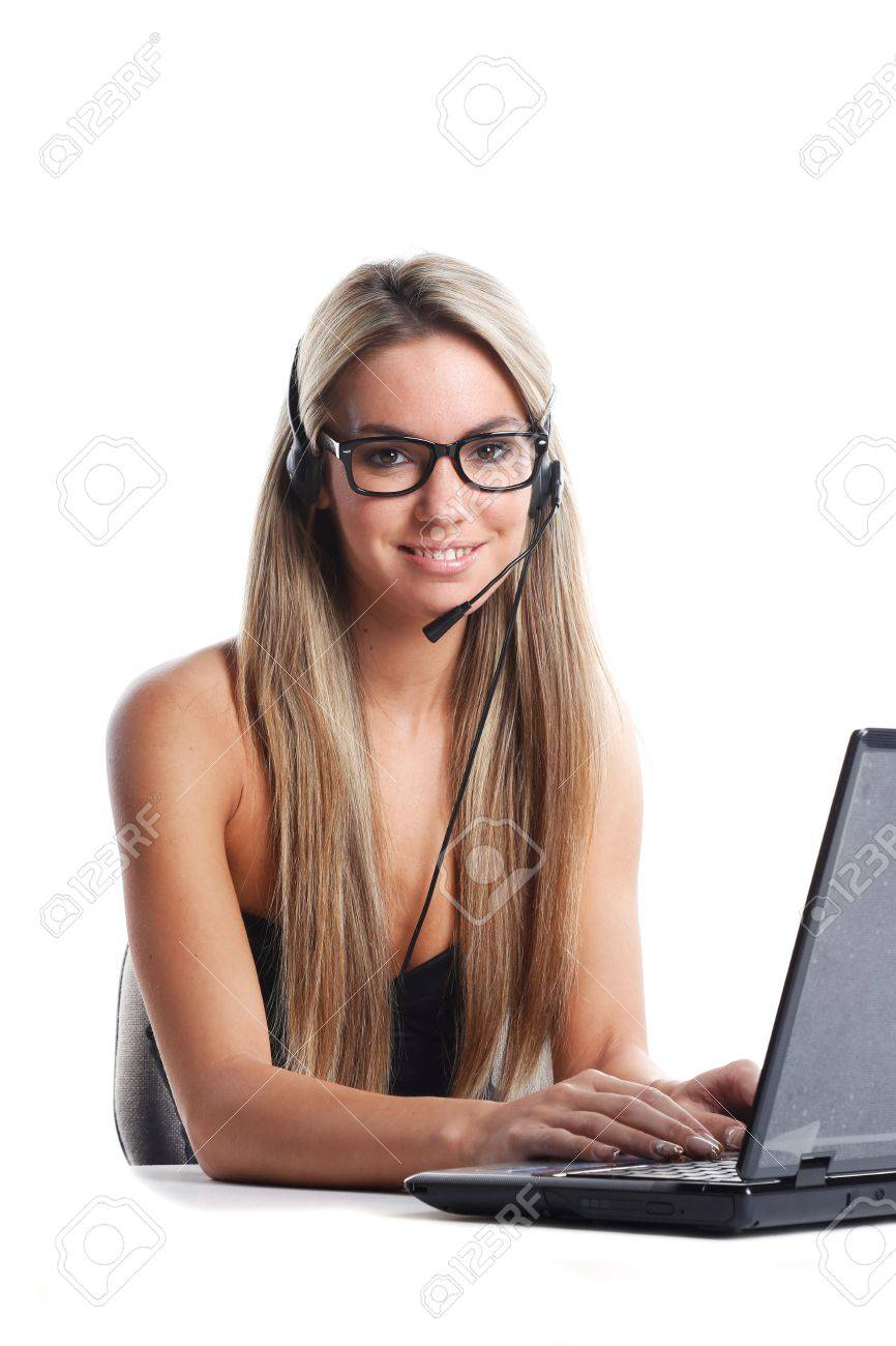 very beautiful woman with long blond hair works as secretary with a headphone and a laptop computer on a white desk and background Stock Photo - 16692927