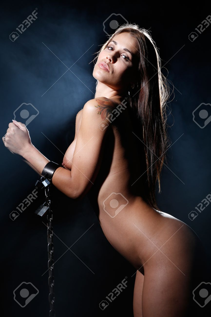 bondage art style with nude woman tied up with a chain and cuffs