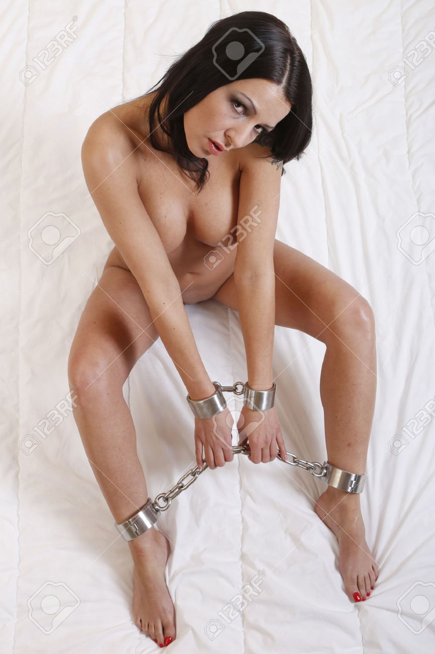 beautiful nude or naked woman bound in bondage style with hard