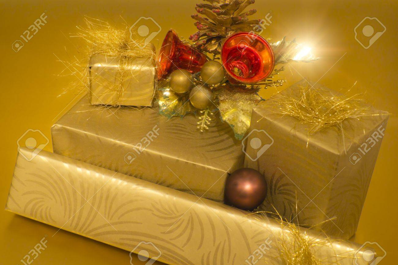 Christmas gifts on golden background Stock Photo - 11124088