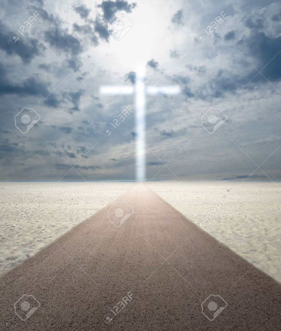 Road in sand leading to glowing cross out of sky Stock Photo - 11855290