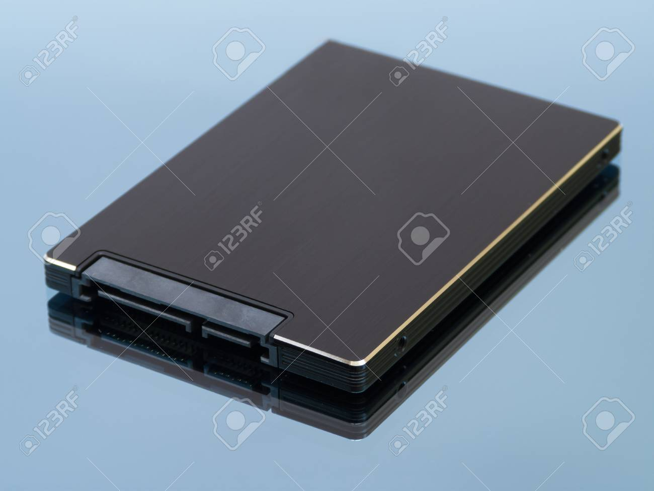 Solid state drive on blue background with reflection Stock Photo - 14855511