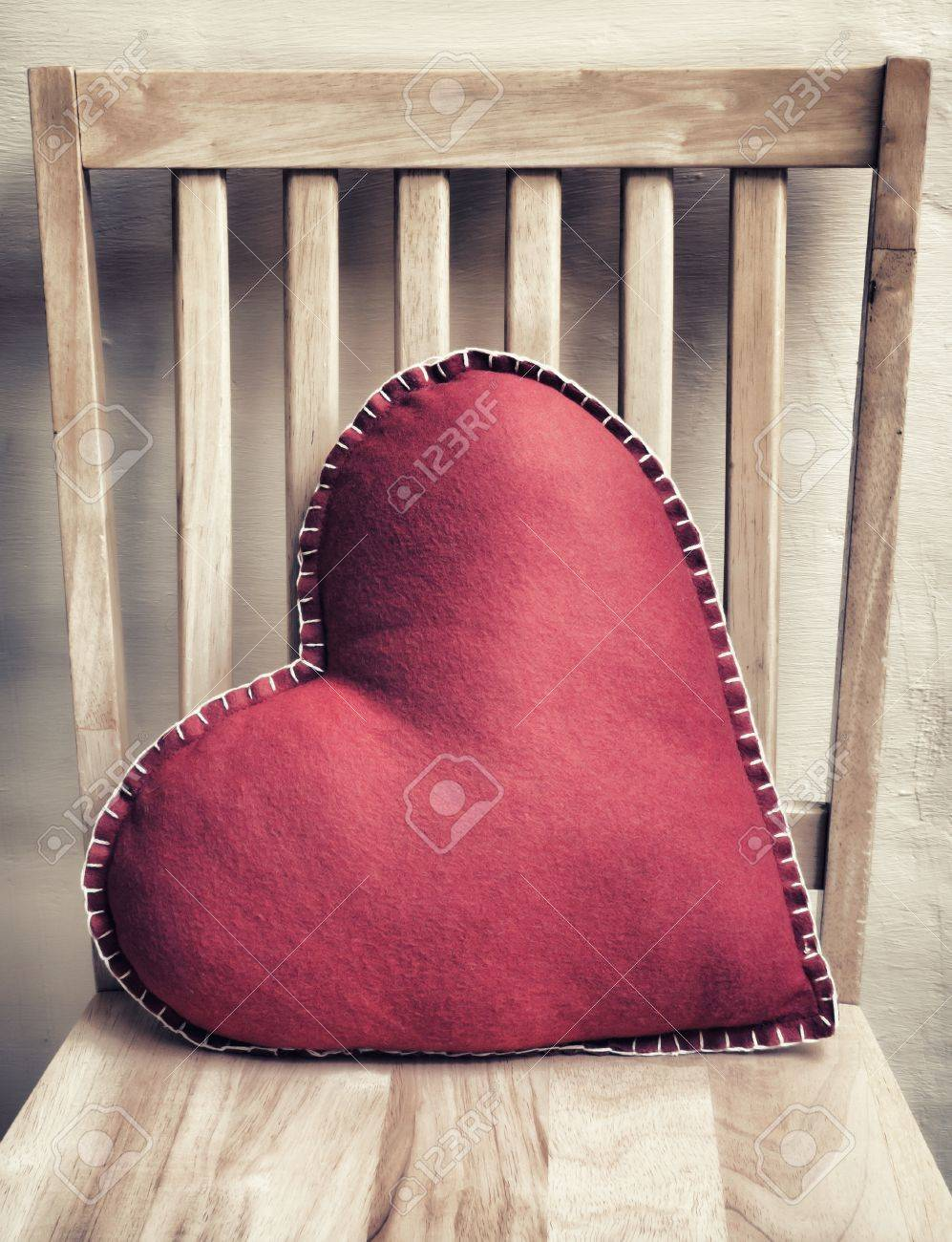 Heart Shaped Pillow On Wooden Chair With Vintage Look Stock Photo   17712392