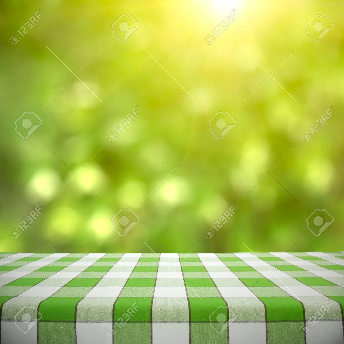 Picnic Table Background empty picnic table on green foliage bokeh background stock photo