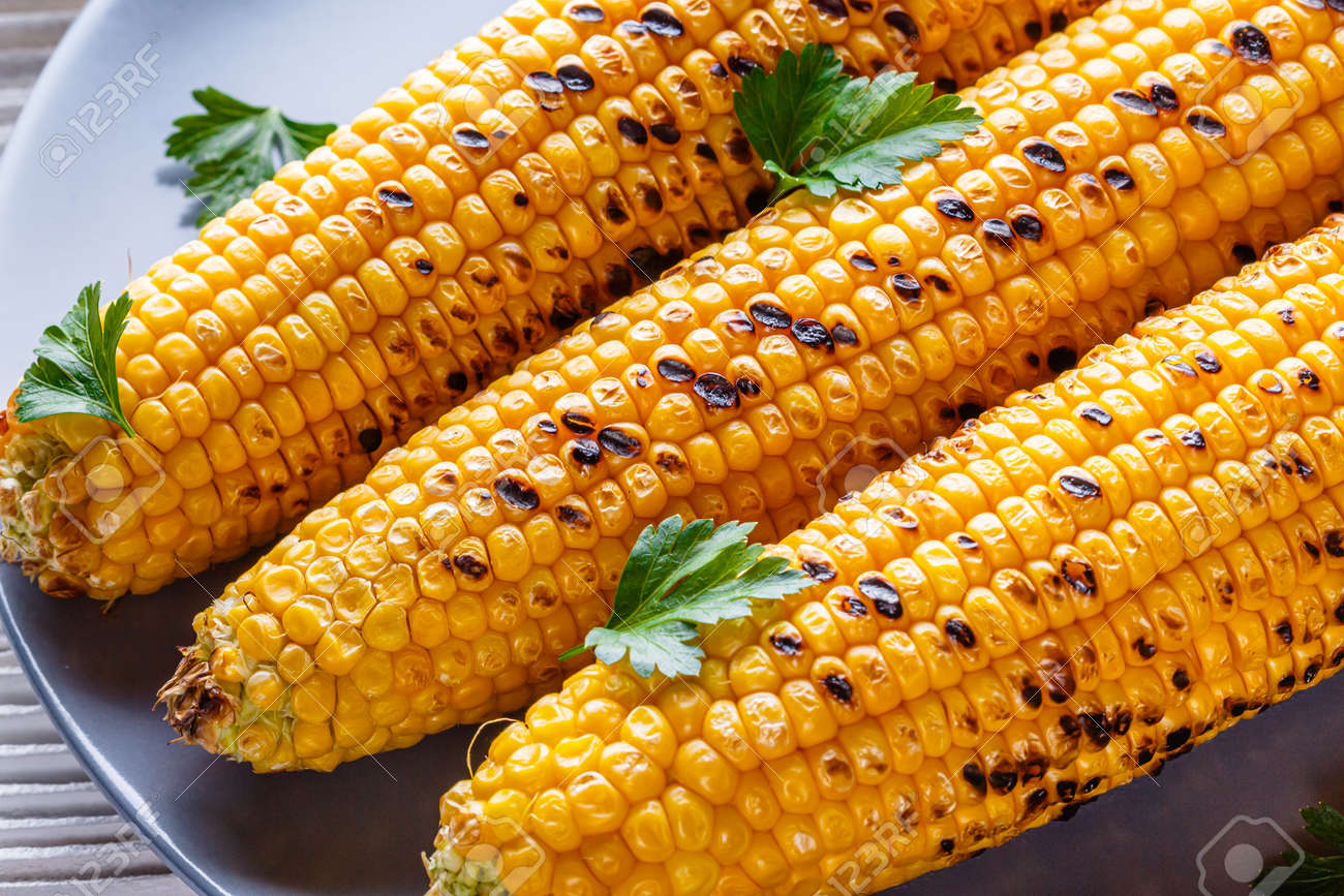 grilled corn cob on white wooden rustic background. - 168727143