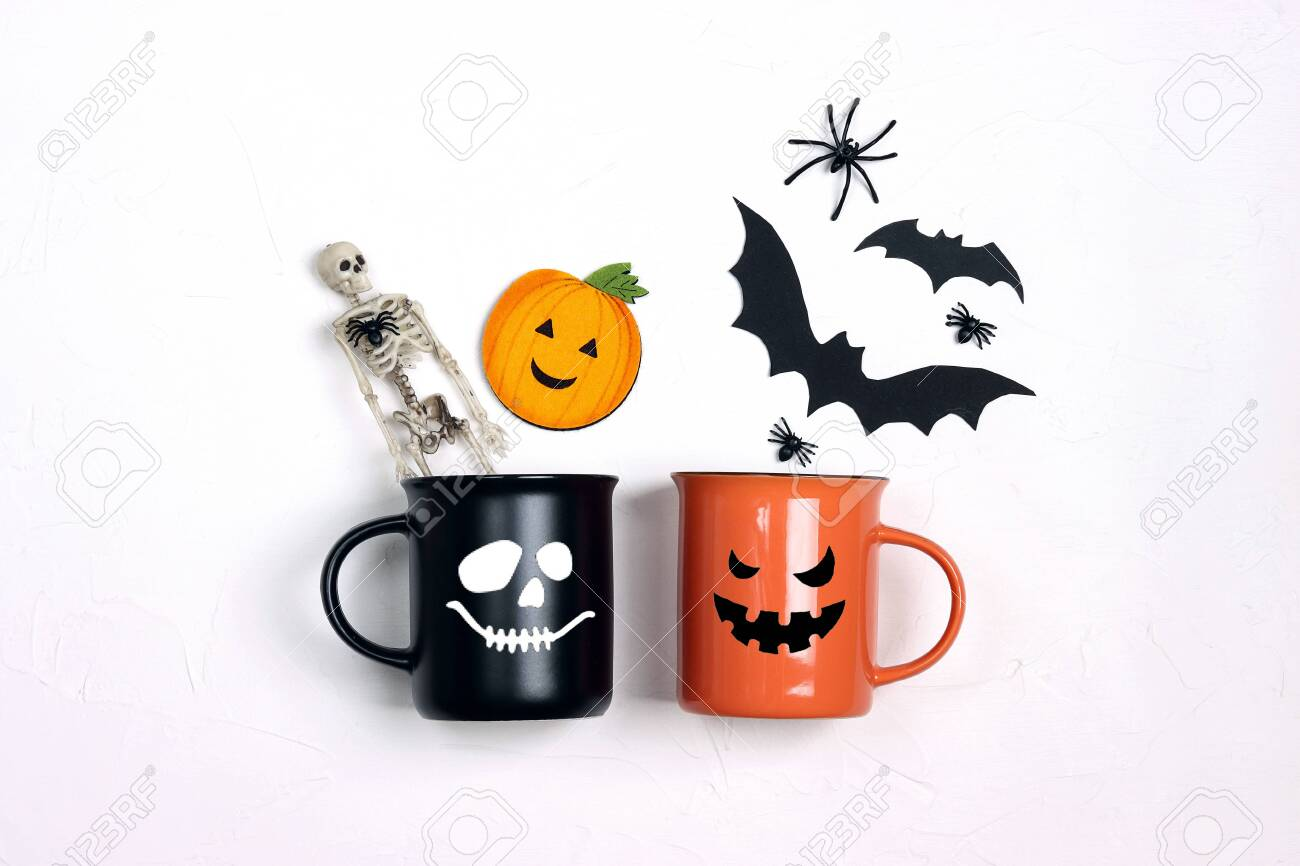 Black And Orange Mugs With Funny Faces And Halloween Decorations Stock Photo Picture And Royalty Free Image Image 157129044
