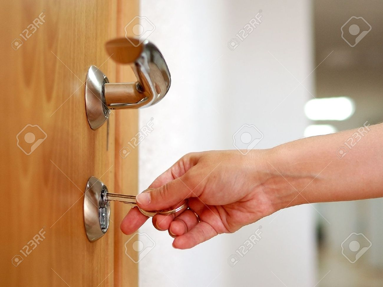 Locking up or unlocking the door with a key in hand Stock Photo - 7673991 & Locking Up Or Unlocking The Door With A Key In Hand Stock Photo ...