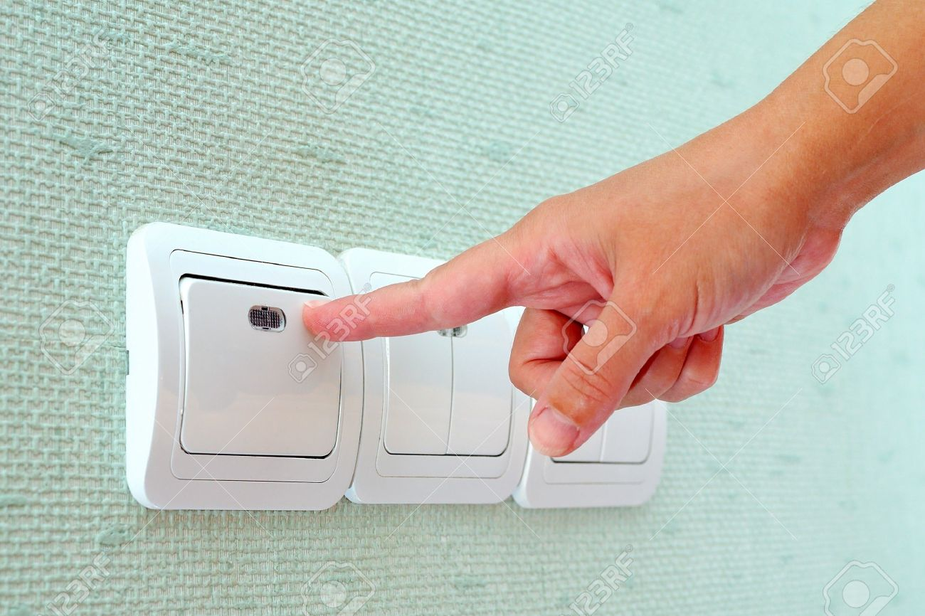 Turning off or turning on the wall-mounted light switch Stock Photo - 7859506