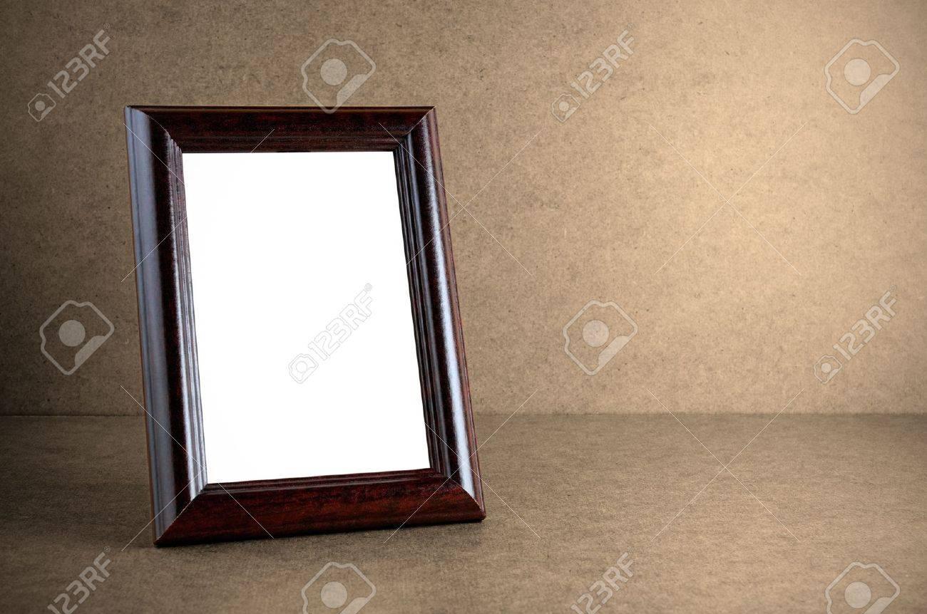 Old wooden photo frame on grunge background - 12748596