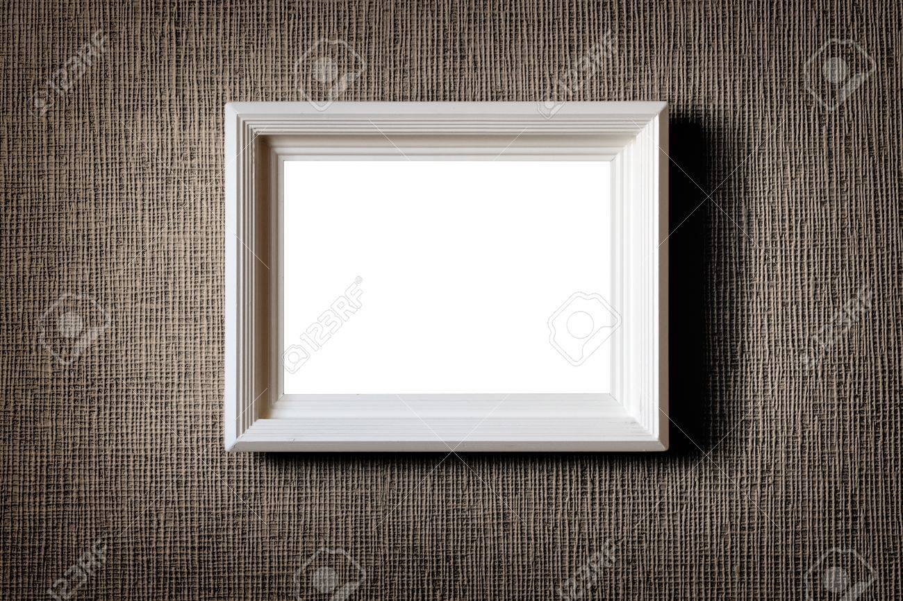 Old wooden picture frame on wall background - 13160711