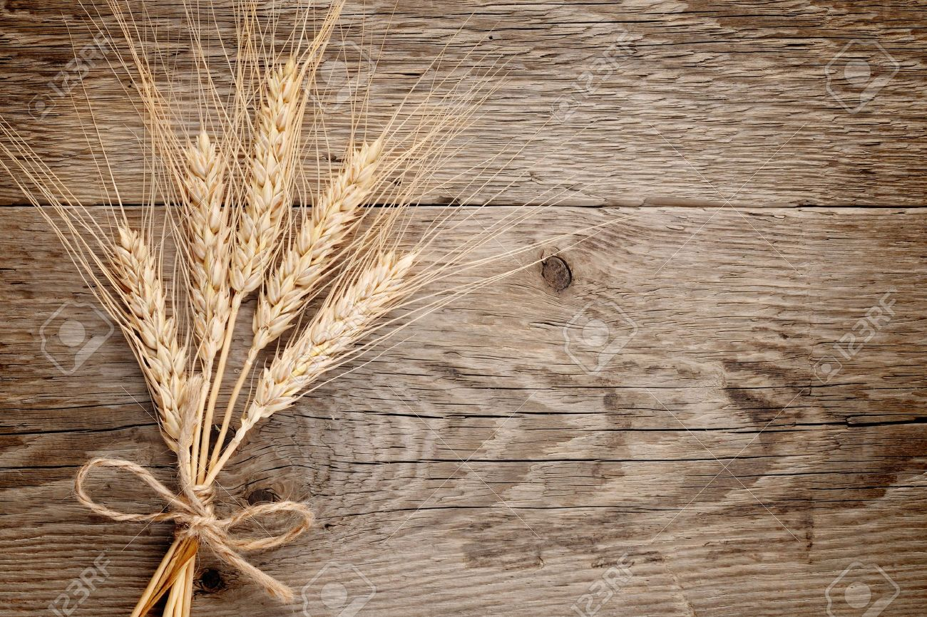 Wheat ears on wooden background - 14229459