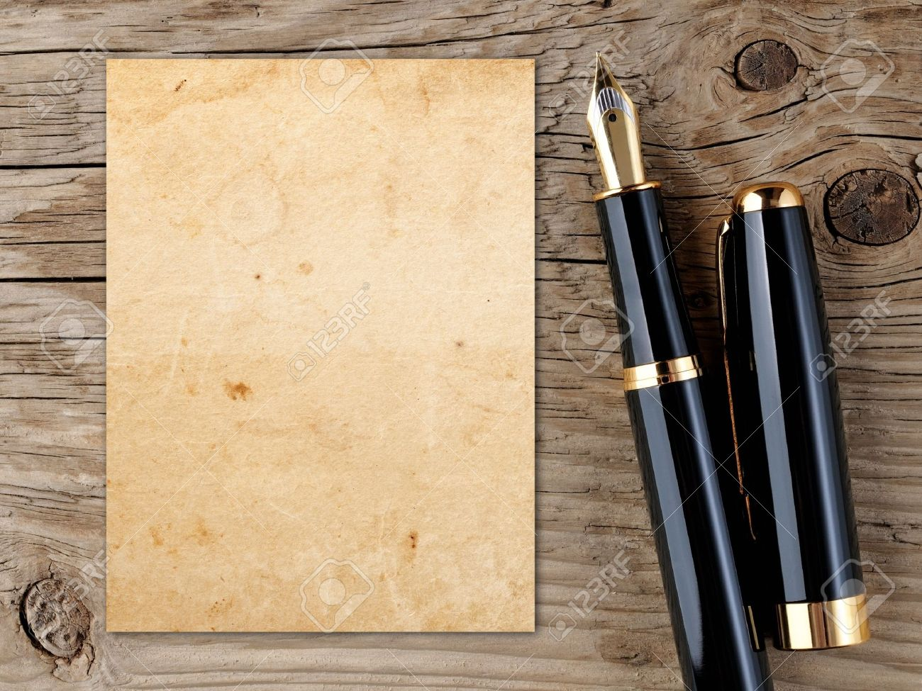 Fountain pen and vintage paper on old wooden background - 17442327