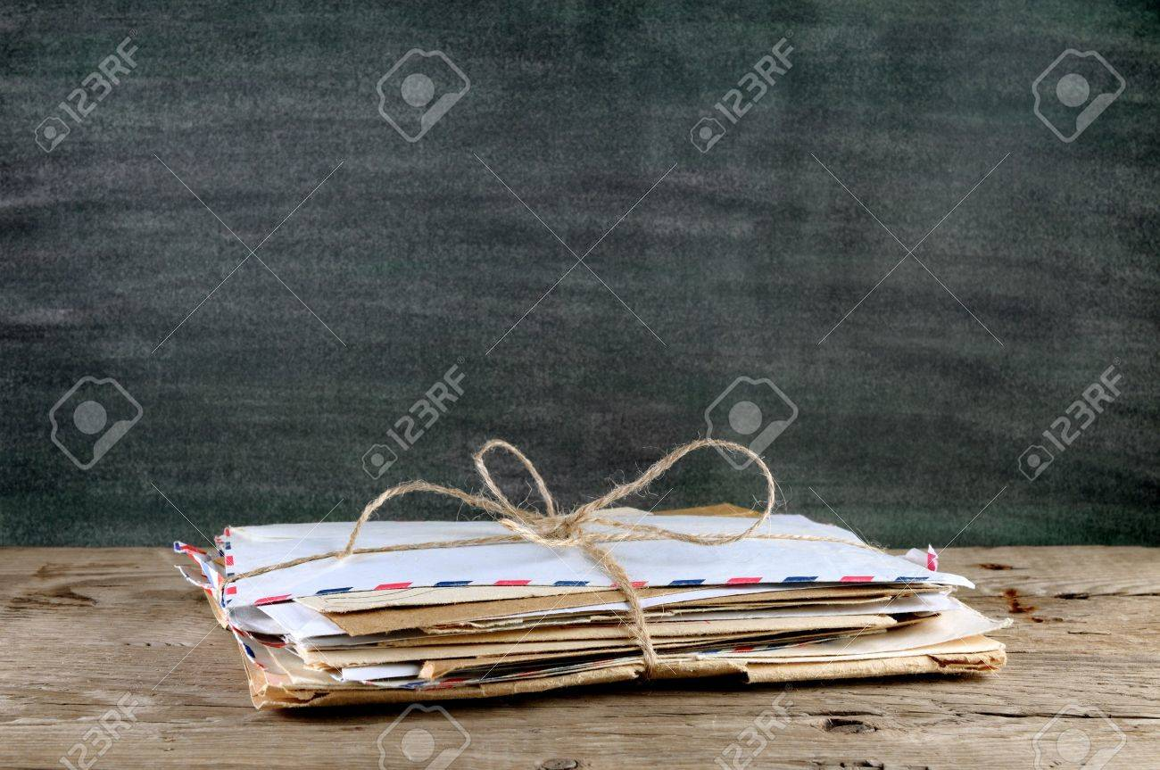 Pile of old envelopes on wooden table - 18001366