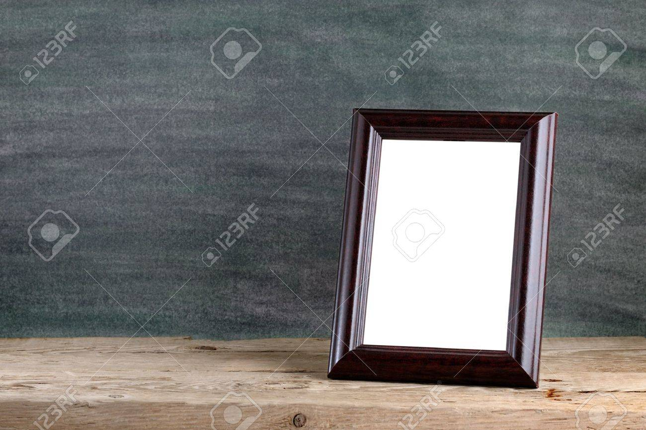 Old photo frame on wooden table - 18001365