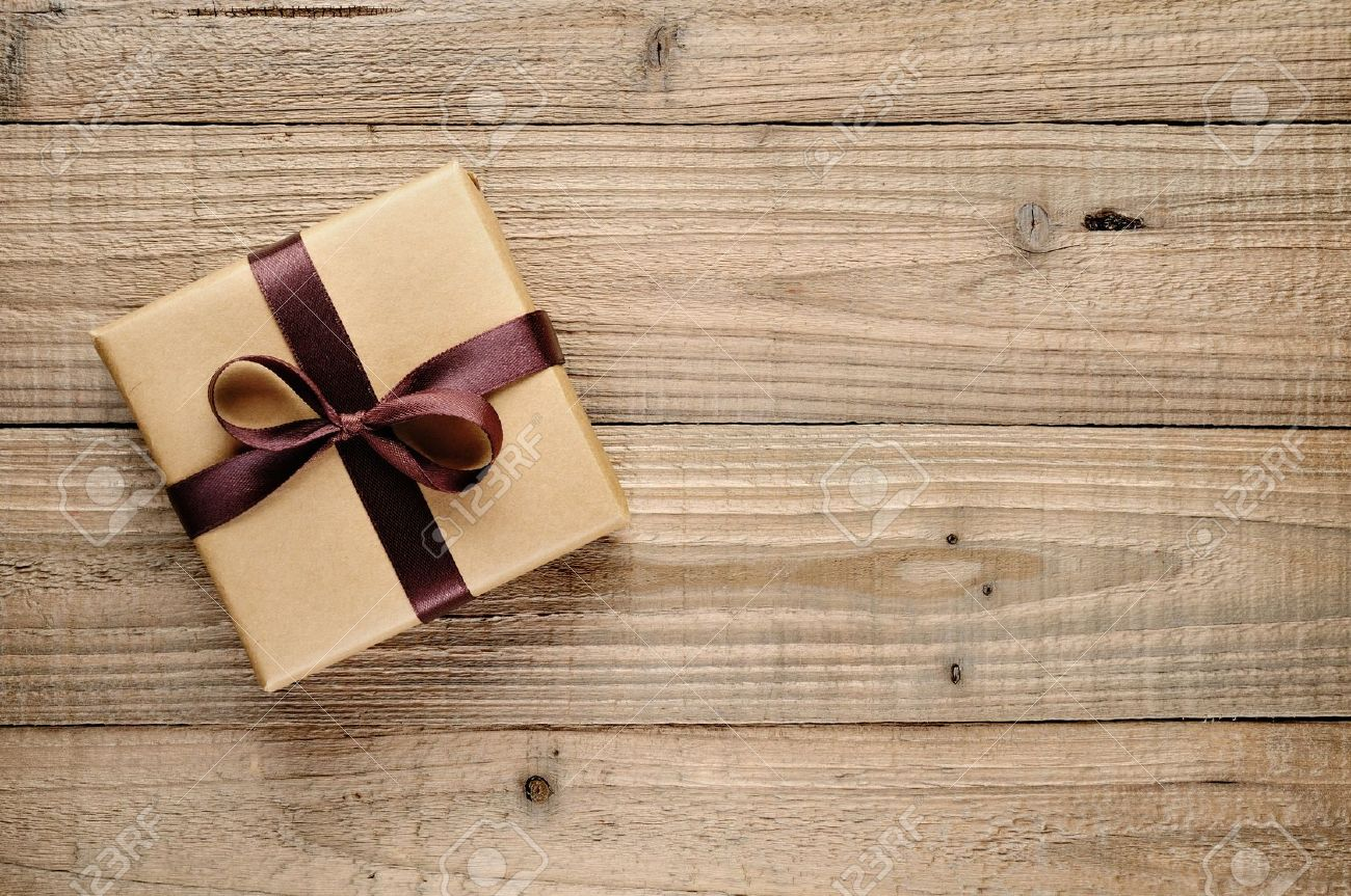 Vintage gift box with bow on wooden background - 20688738