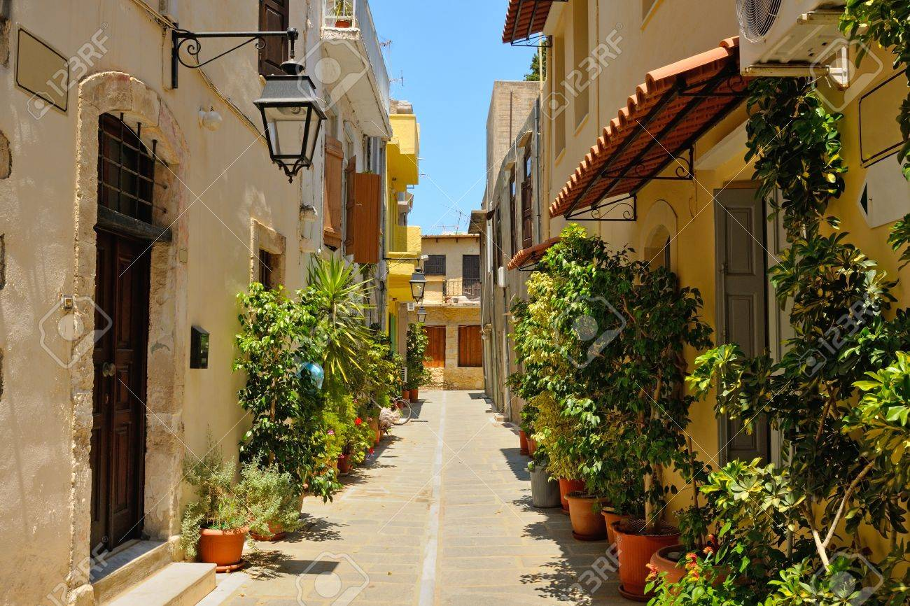 Typical narrow street in city of Rethymno, Crete, Greece - 21436584