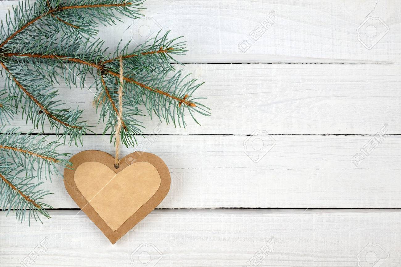 Paper heart and branches of blue spruce on wooden background - 23860272