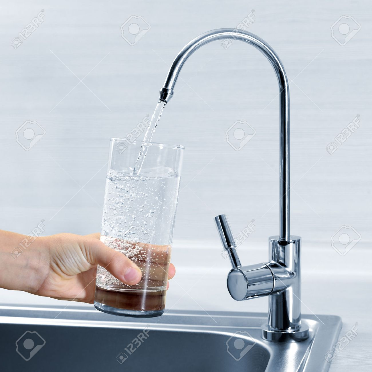 Filling Glass Of Water In Hand From Kitchen Faucet Stock Photo ...