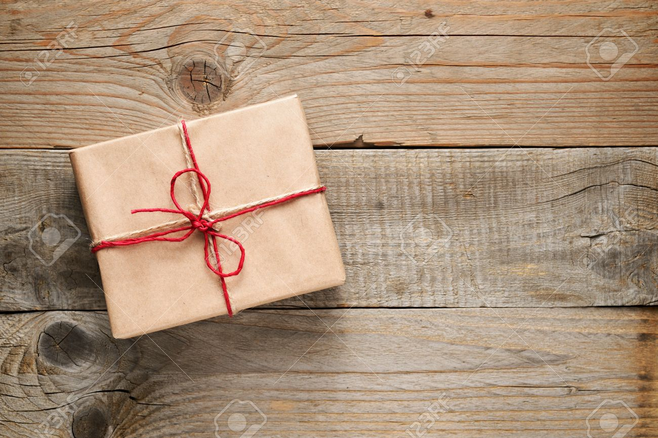 Gift box top view on wooden background - 39386777
