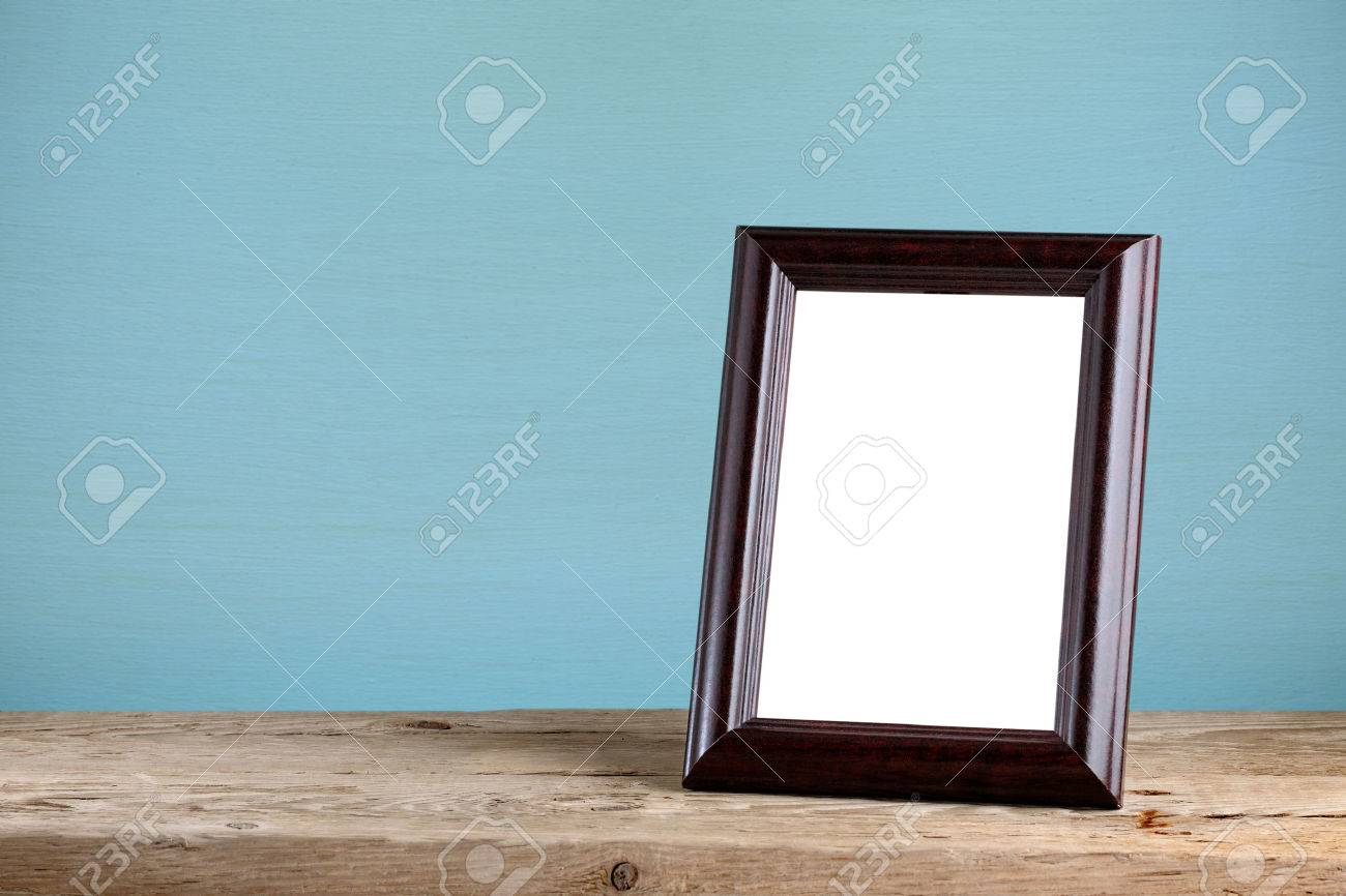 Photo frame on old wooden table - 44186245