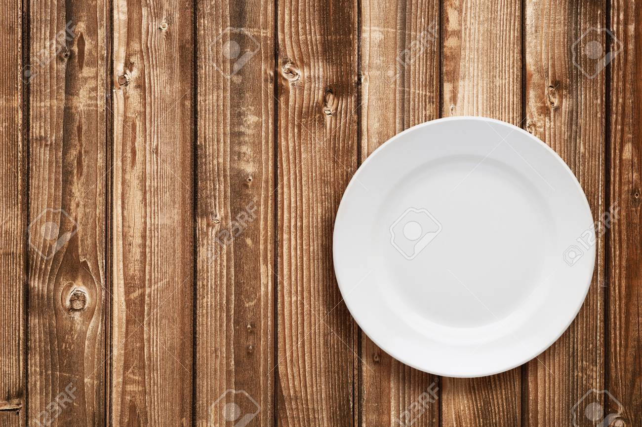 Empty Plate Top View On Wooden Table Stock Photo Picture And Royalty Free Image Image 47258410