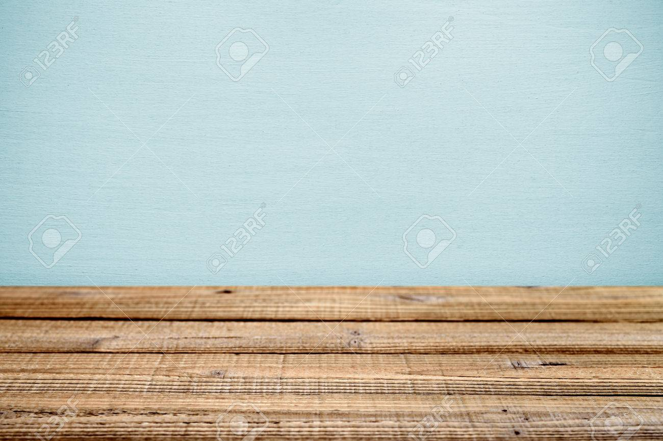 old wooden table near wall shallow depth of field stock photo