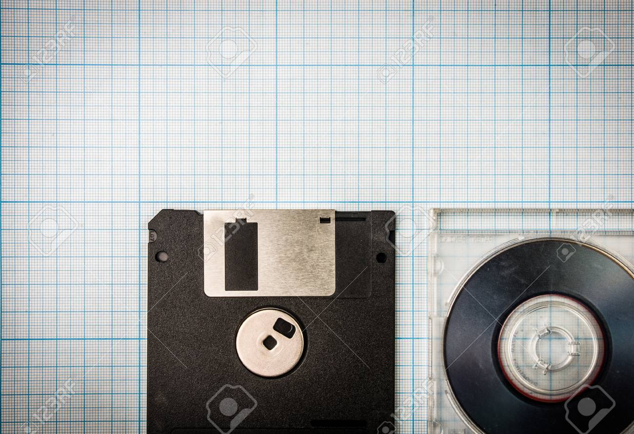 Vintage background computer floppy disks and mini cd on the stock photo vintage background computer floppy disks and mini cd on the blueprint paper toned malvernweather Image collections