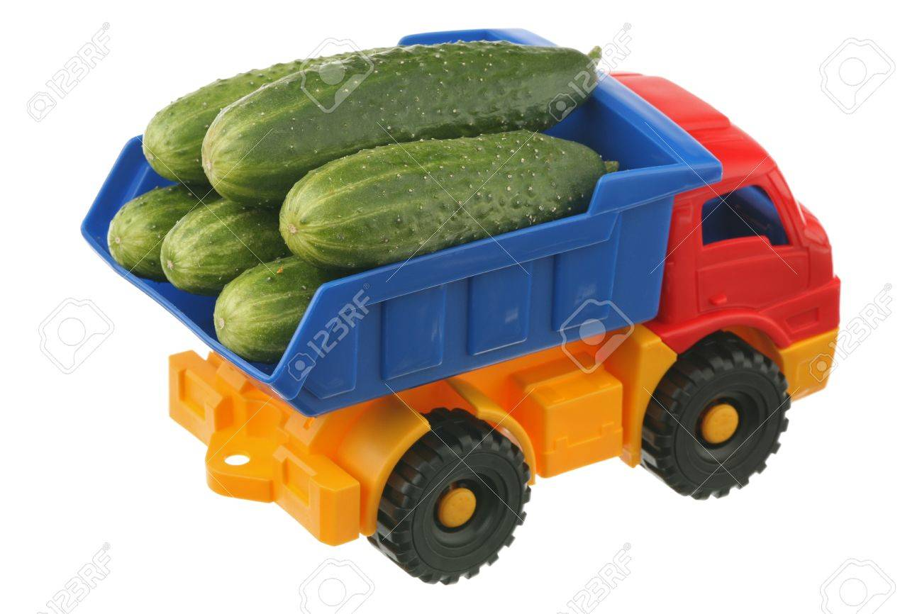 Fresh cucumbers in the truck it is isolated on a white background Stock Photo - 9542561