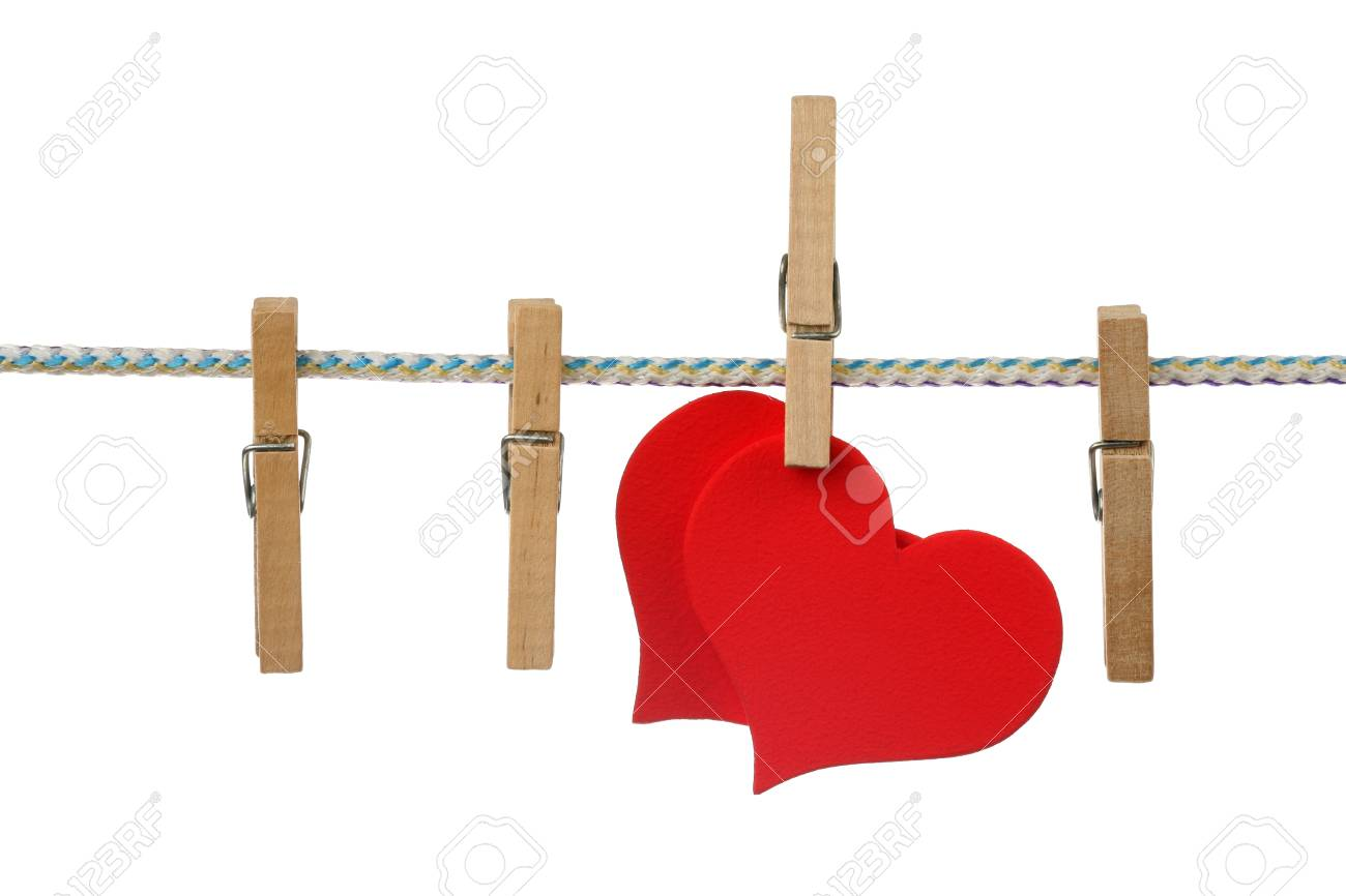 Two red hearts dry on clothesline Stock Photo - 10527416