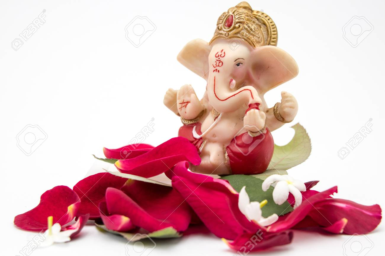 Lord Ganesha Idol With Rose Petals White Flowers And Leaves