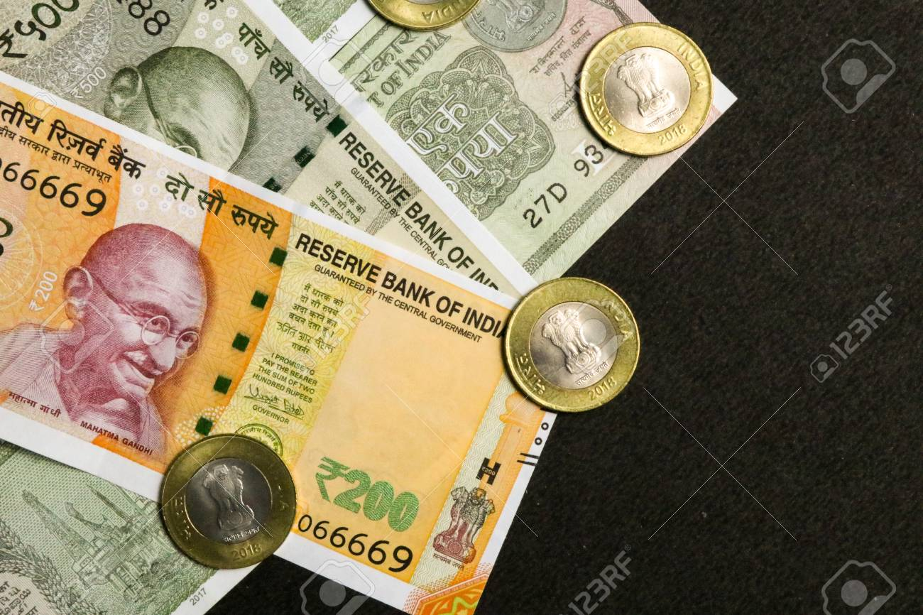 new indian currency, 200, 500 and one rupees note with coins