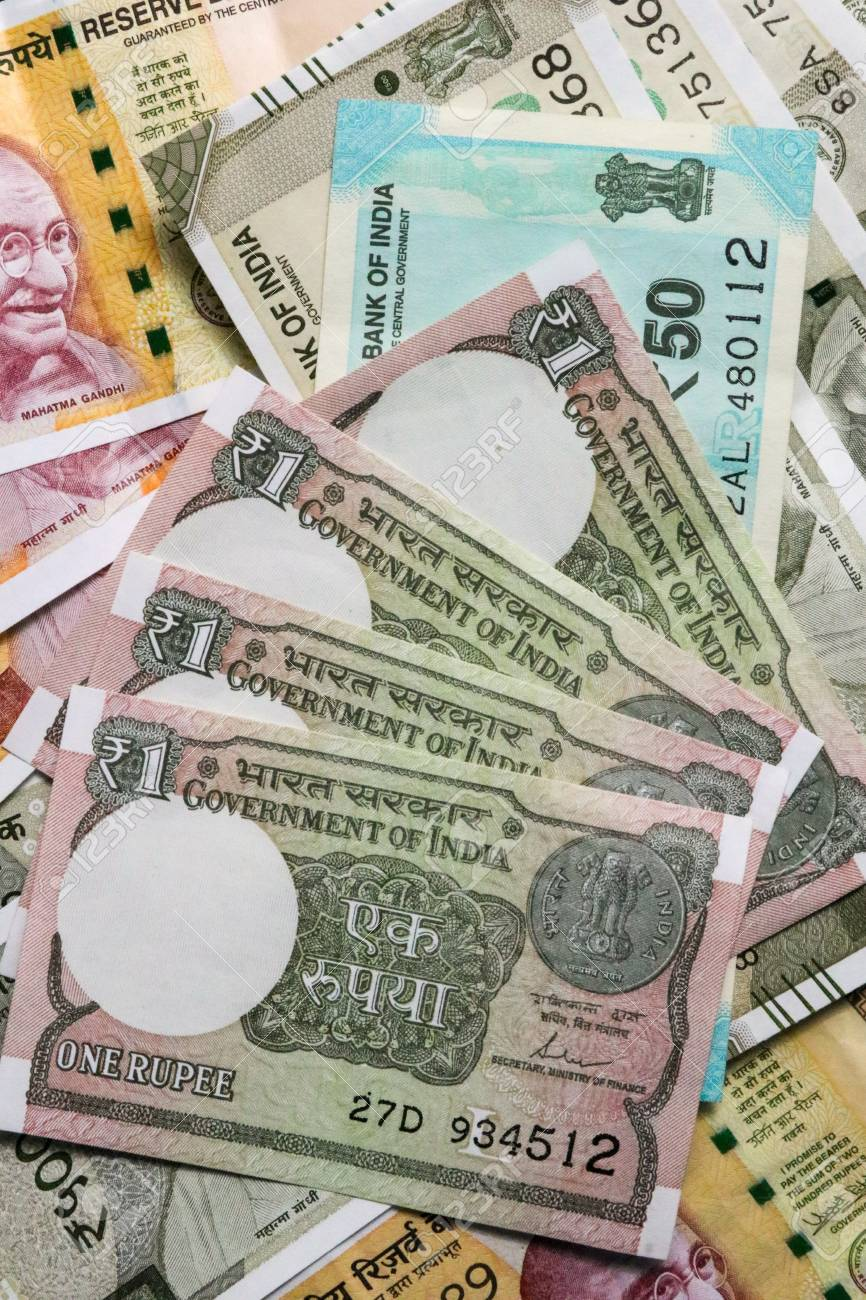 new indian currency, 200, 500 and one rupees note as background