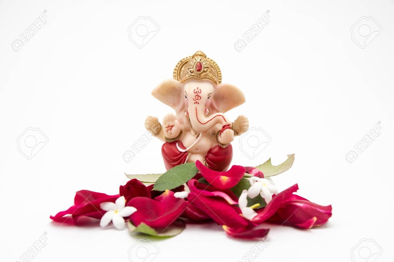 Lord Ganesha Idol With Rose Petals On White Background Ganesh
