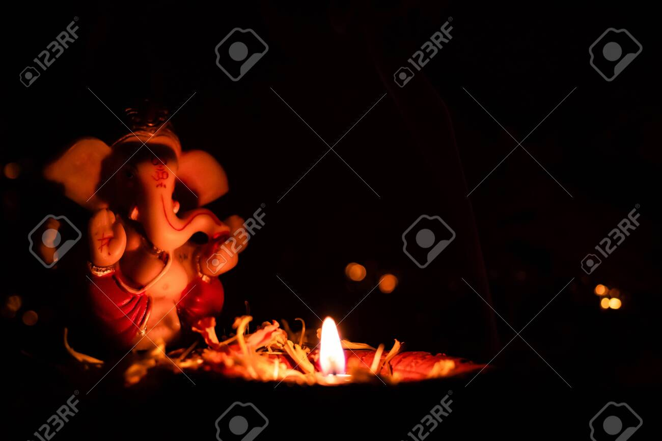 Low Light Photography Of Beautiful Earthen Lamp And Ganesha Statue Stock Photo Picture And Royalty Free Image Image 141544539