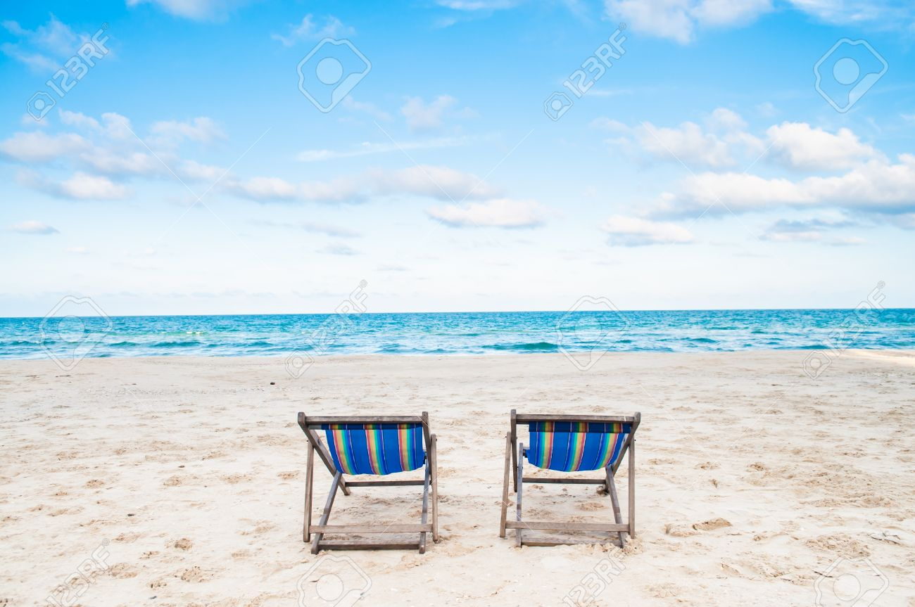 Genial Beach Chairs On White Sand Beach With Cloudy Blue Sky Stock Photo   18698059