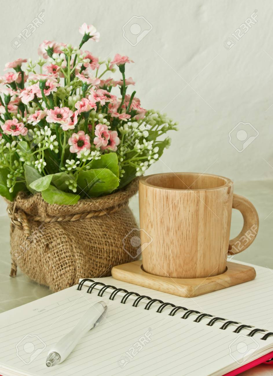 notebook with pen and cup Stock Photo - 9658347