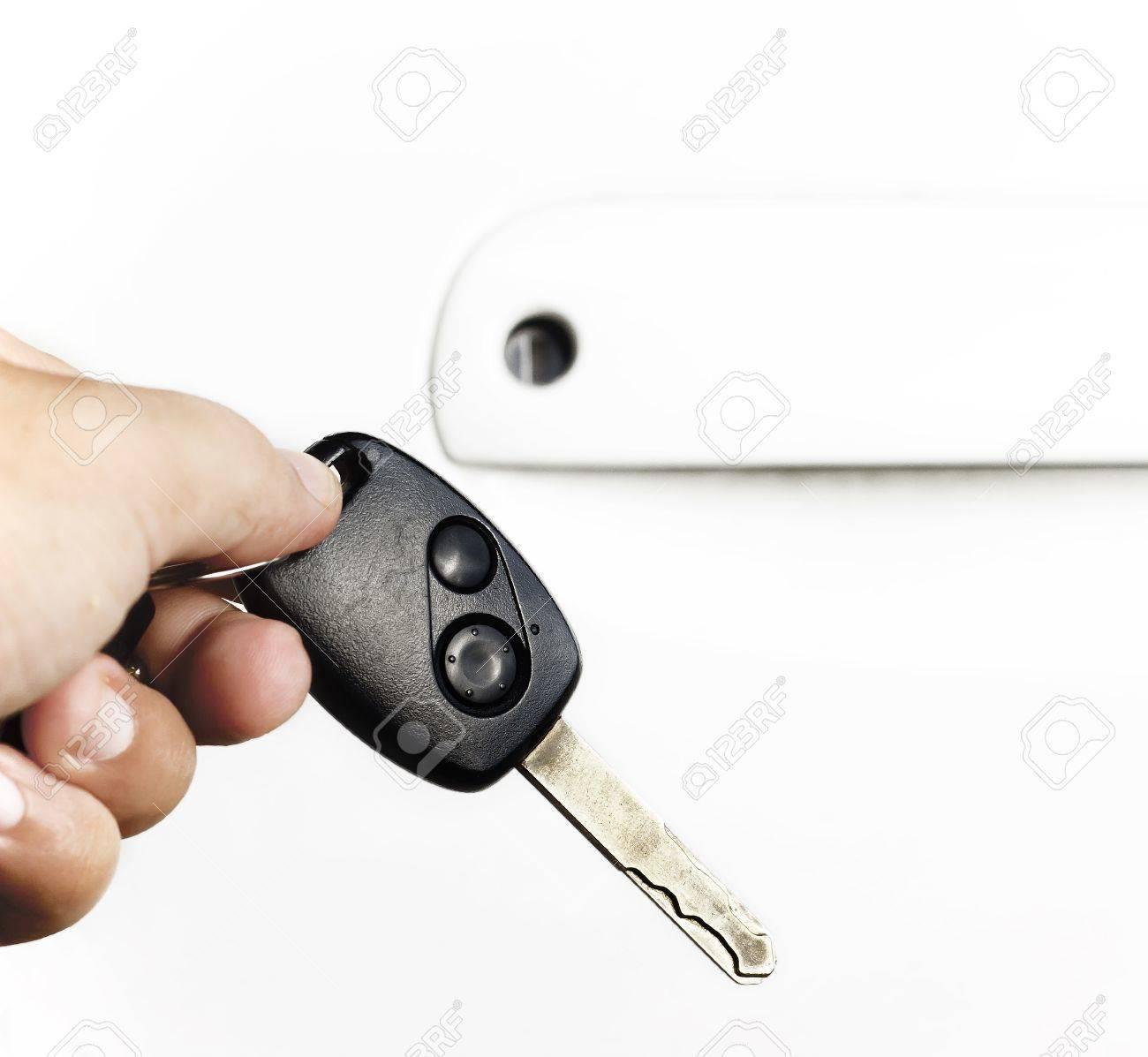 hand holding car keys over white Stock Photo - 10610400