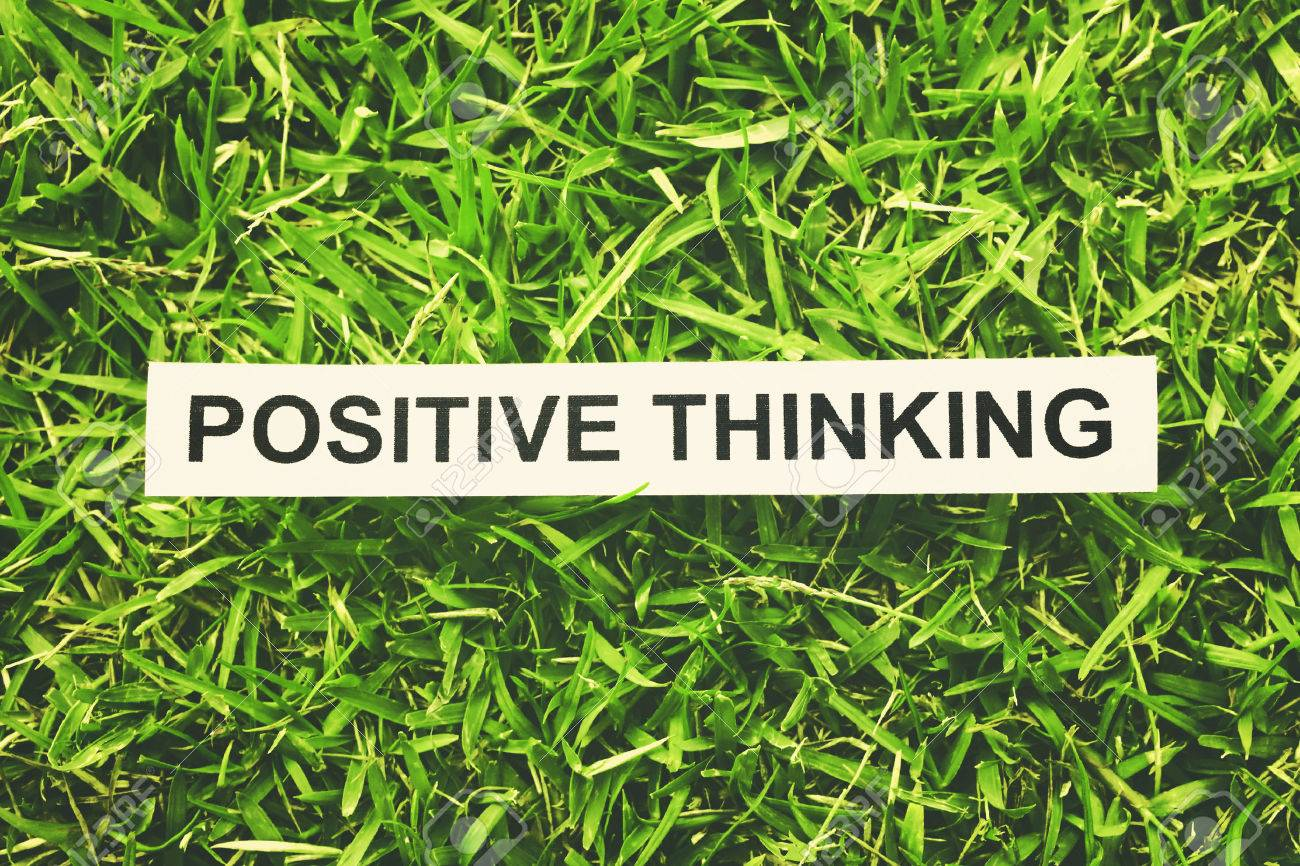 word positive thinking paper on green grass retro style stock word