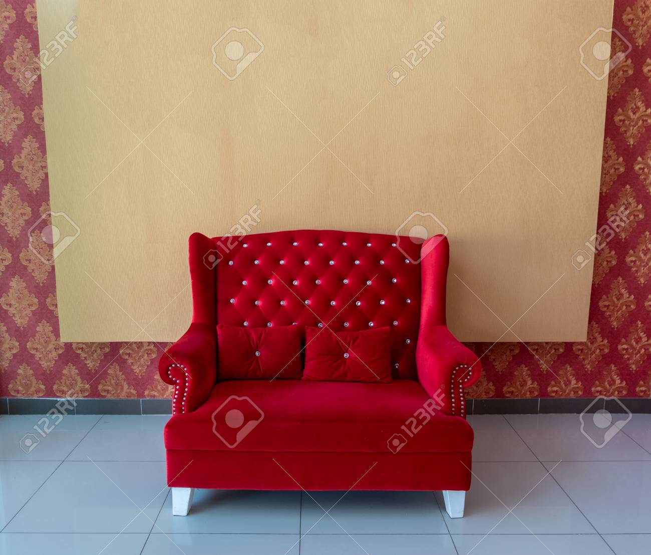 Elegant red sofa with blank backdrop texture background