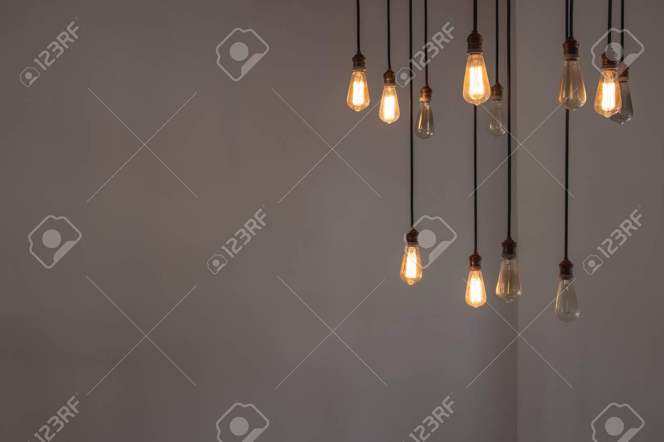 Idea concept with good and broken light bulbs hanging from ceiling foto de archivo idea concept with good and broken light bulbs hanging from ceiling aloadofball Gallery