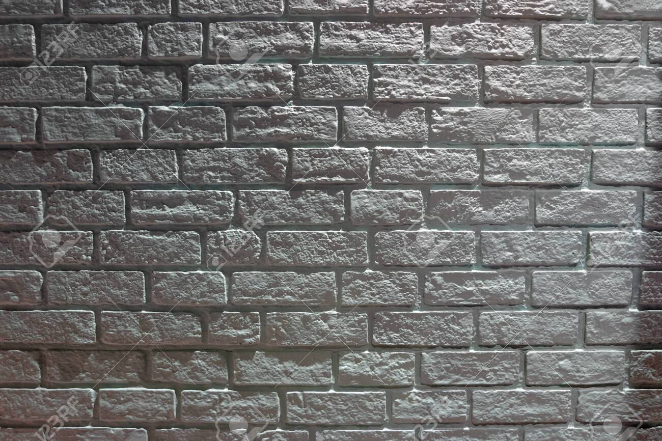 Dark Brick Wall With Light And Shadow Background Stock Photo Picture And Royalty Free Image Image 137600067