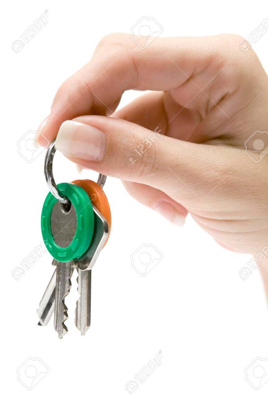 Female hand holding a bunch of keys. Isolated on a white background. Stock Photo - 2097665